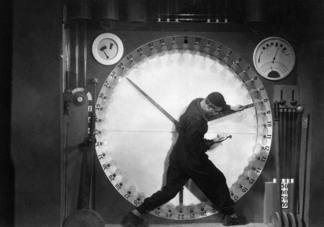 Metropolis man on clock